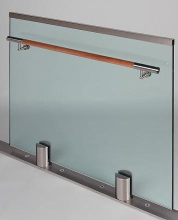 Closeup Studio shot of 2 metal round Optik POD mounting hardware with glass infill & wood rail