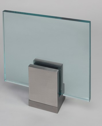 Closeup Studio shot of metal square Optik POD mounting hardware with glass infill