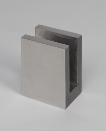 Closeup Studio shot of metal square Optik POD mounting hardware