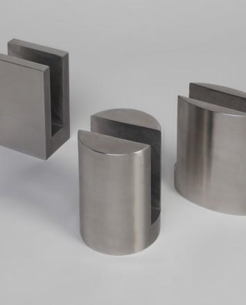 Closeup Studio shot of three types of metal Optik POD mounting hardware