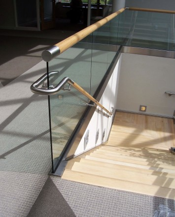 Downward view of Office, PA, Optik Shoe with wood cap staircase