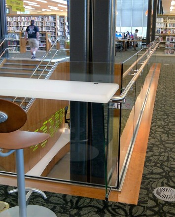 Corner view of Los Gatos Library, Optik Shoe with wood handrails and custom shelf