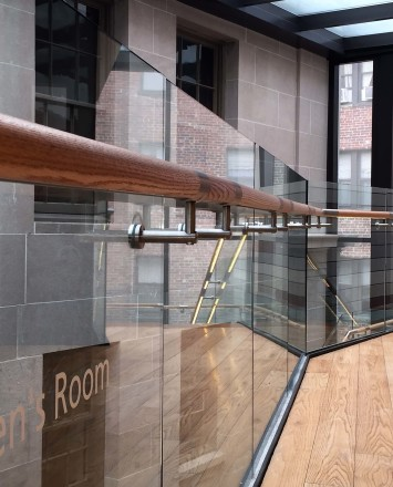 Close angle view of Mount Pleasant Library, Washington DC, Optik Shoe with wood handrail and LED